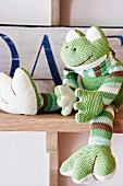 Knitted froggy decorating child's bedroom