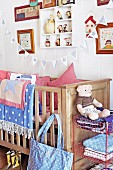 Nursery with wooden cot, blankets, cushions & bunting