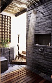 A shower on a covered terrace