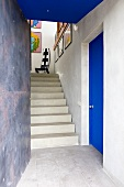 Staircase with pictures on wall (Villa Nalu, Southern France)