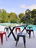 Designer table and stools by swimming pool