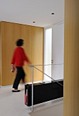 Woman walking through room (Villa Bamboo, Southern France)