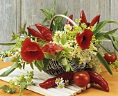 Arrangement of flowers and chili peppers
