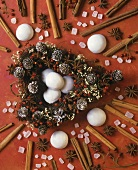 Christmas decoration with spices and gingerbread cookies