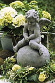 Hydrangeas and a cherub on a terrace