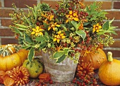 Autumnal arrangement of montbretia, rose hips and dogwood