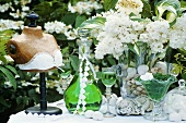 May-time decoration: woodruff liqueur, bust, lilac