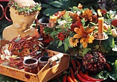 Arrangement of late summer flowers, chilli wreath on tray