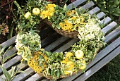 Heart-shaped arrangement of willow and late summer flowers