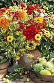 Arrangement of summer flowers, berries and herbs