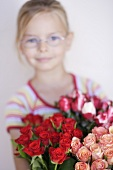 Girl holding a bouquet of roses