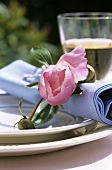 Place setting with flowers in open air