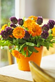 A posy of chive flowers and marigolds
