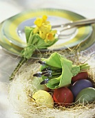Easter nest with coloured eggs & posies