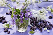 Violets in glass, candied violets and sprigs of blossom