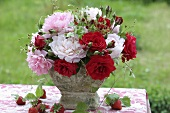 Arrangement of roses, peonies and wild strawberries