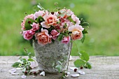 Arrangement of roses with wild strawberries
