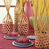 Flower candles in woven baskets