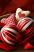 Christmas baubles and fabric hearts in a wooden bowl
