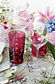 Glasses on festive table with floral decorations