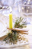 Christmas decoration: burning candle on clothes peg