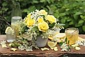 Vase of yellow roses and elderflowers