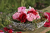 Roses on moss in wire basket