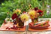 Autumn table decoration of dahlias and rose hips
