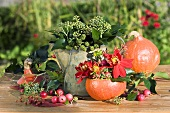 Autumn decoration: ivy, pumpkin, dahlias & ornamental apples