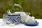 Tableware in basket, white hydrangeas