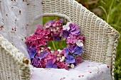 Hydrangea wreath in wicker chair