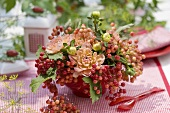 Posy of guelder rose berries & dahlias (table decoration)