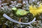 Green glass bird with Christmas greeting on box tree