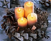 Advent wreath of bark, twigs and dates with candles