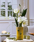 Christmas arrangement of amaryllis, aspidistra, bear grass