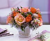 Arrangement of roses, limonium and pittosporum