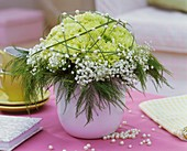 Arrangement of carnations, gypsophila, asparagus fern, bear grass