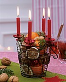 Advent wreath with dried citrus fruit, nuts, candles