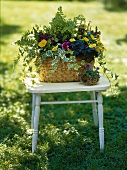 Flower arrangement in a basket out of doors