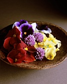 Edible flowers on a wooden plate