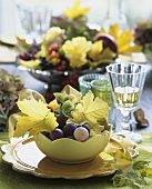 Bowls of fruit with autumn flowers and leaves