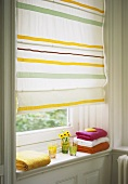 Striped roller blind at bathroom window
