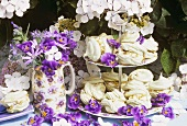 Pistachio meringues on tiered stand, floral decoration