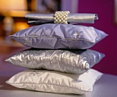 Stack of cushions and napkin with ring