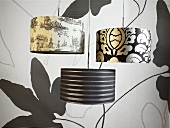 Pendant lights with wallpaper with a black and white designe