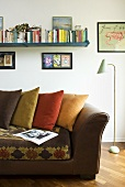 Leather sofa with colored pillows and fifties style floor lamp