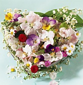 Heart of horned violets, roses, lilies of the valley, chamomile