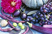 Still life with vegetables and grapes in shades of purple
