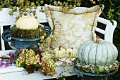 Garden seat with autumn decorations (hydrangeas etc.)