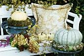 Garden seat with autumn decorations (hydrangeas etc.)